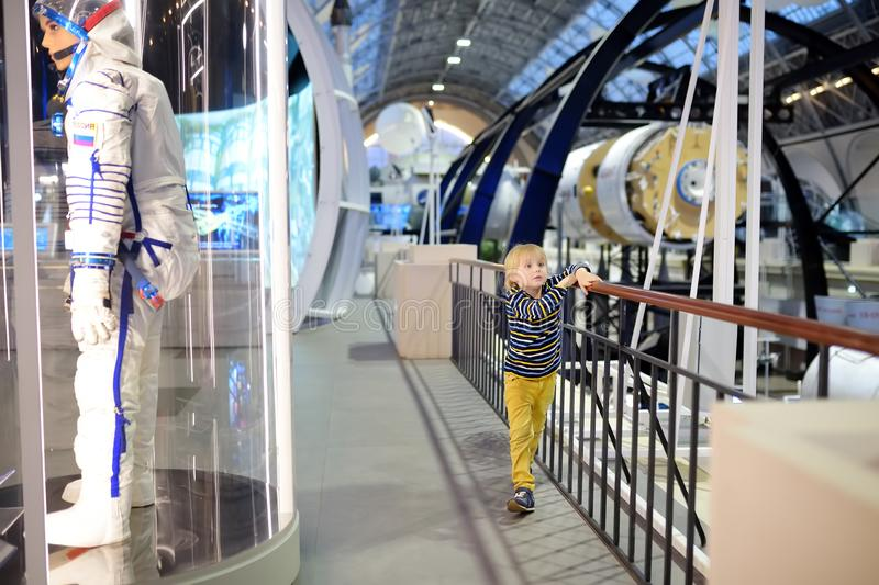 Moscow, Russia - May 24, 2019: Little boy looking exhibits an exposition in pavilion of Space at VDNH exhibition. Moscow, Russia - May 24, 2019: Little boy stock image