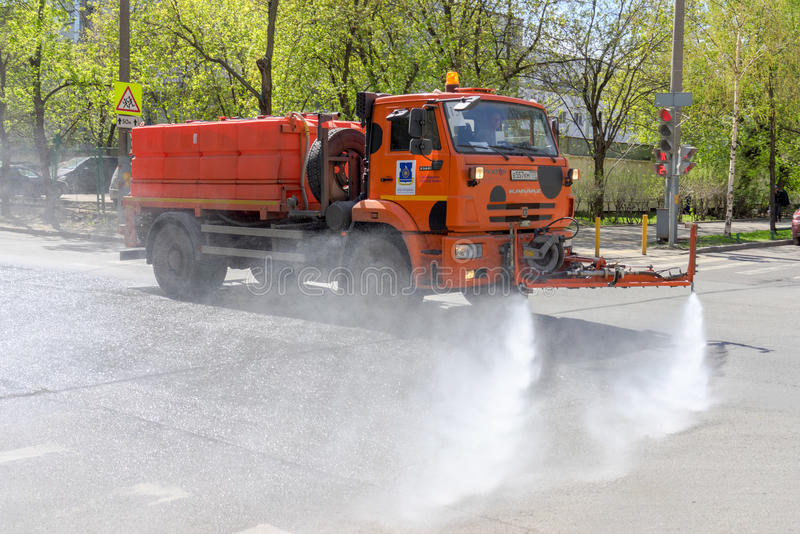 MOSCOW, RUSSIA - MAY 08,2015: Multipurpose road machine KamAZ which can operate as dump truck or as street cleaner for washing royalty free stock photo
