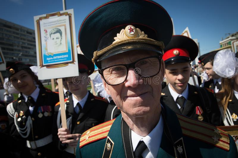MOSCOW, RUSSIA - MAY 9, 2018: An old veteran walks in the procession of an immortal regiment dedicated to the memory of those. MOSCOW, RUSSIA - MAY 9, 2018: An stock photos