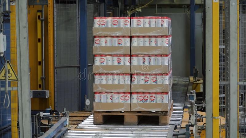 Moscow, Russia - May, 2017: Packed box on production line. Clip. Cardboard boxes on conveyor belt in factory.  royalty free stock image