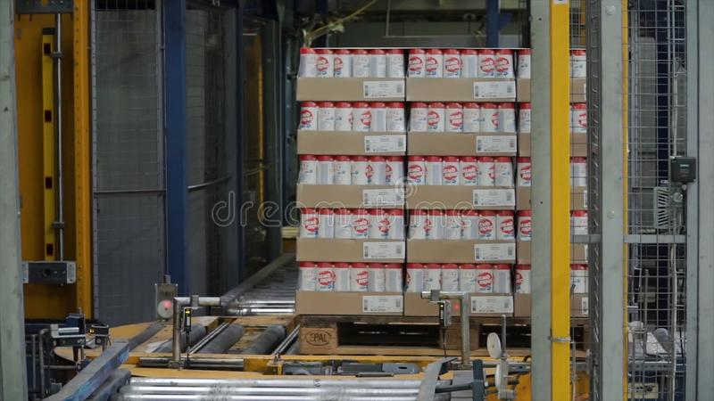 Moscow, Russia - May, 2017: Packed box on production line. Clip. Cardboard boxes on conveyor belt in factory.  stock photos