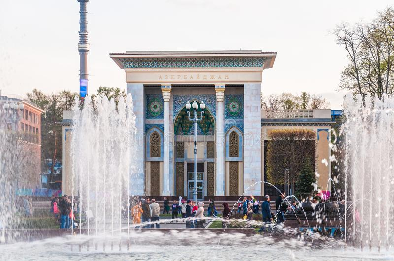Pavilion 14 `Azerbaijan` `Azerbaijan SSR`, `Computer engineering` at VDNH. Jets of the fountain `Stone flower`. MOSCOW, RUSSIA - May 1, 2019: Pavilion 14 ` royalty free stock images