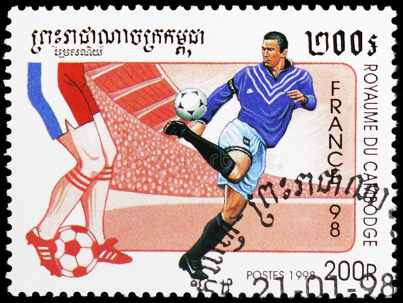 Soccer players, World Cup Football serie, circa 1998. MOSCOW, RUSSIA - MAY 25, 2019: Postage stamp printed in Cambodia shows Soccer players, World Cup Football stock photo