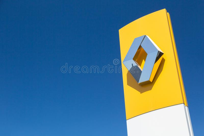 Moscow, Russia - May, 2018: Renault automobile dealership sign against blue sky. Renault-Nissan alliance is one of the biggest car stock photography