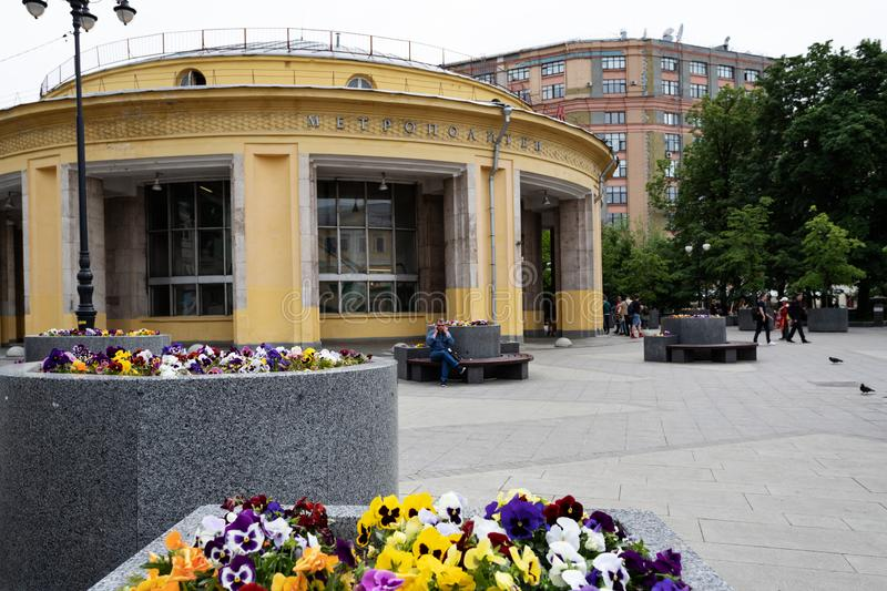 Moscow, Russia, may 25, 2019: round yellow building of Novokuznetsk metro station in the foreground flowerbeds with bright royalty free stock image