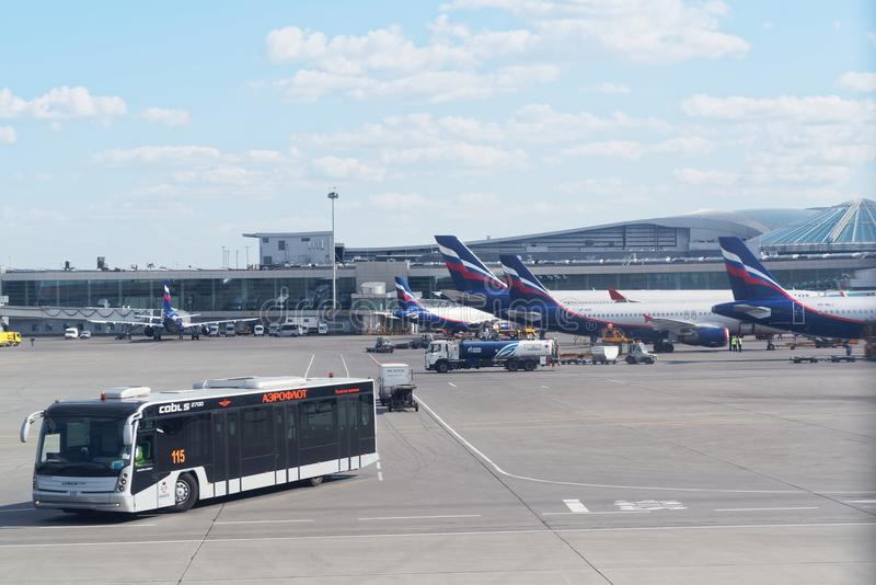Infrastructure at Sheremetyevo international airport. airplanes waiting on terminal gates for passenger. Airport bus is bringing p. Moscow, Russia - May 30, 2018 stock photos