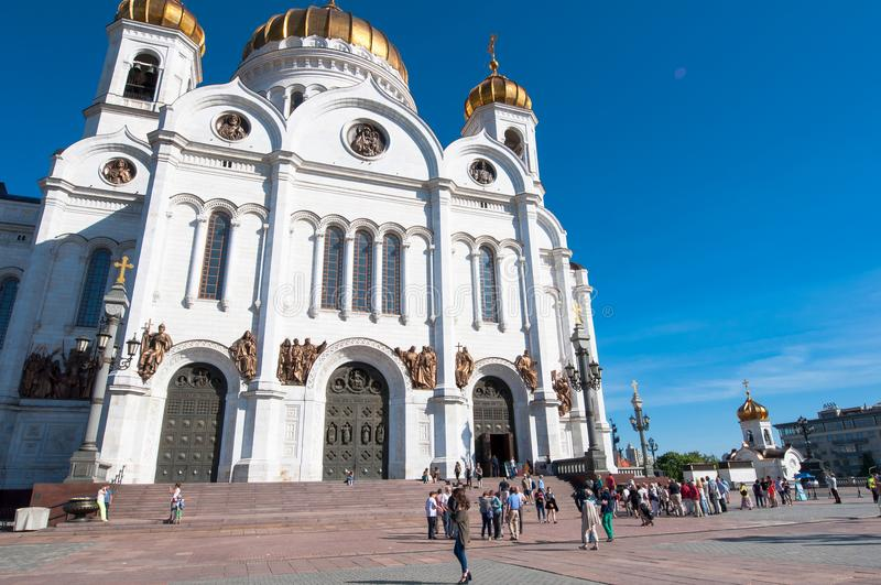 Side view of the rebuilt Cathedral of Christ the Saviour during the midday, locals and tourists go sightseeing. Moscow, Russia-May 27, 2018: Side view of the stock images