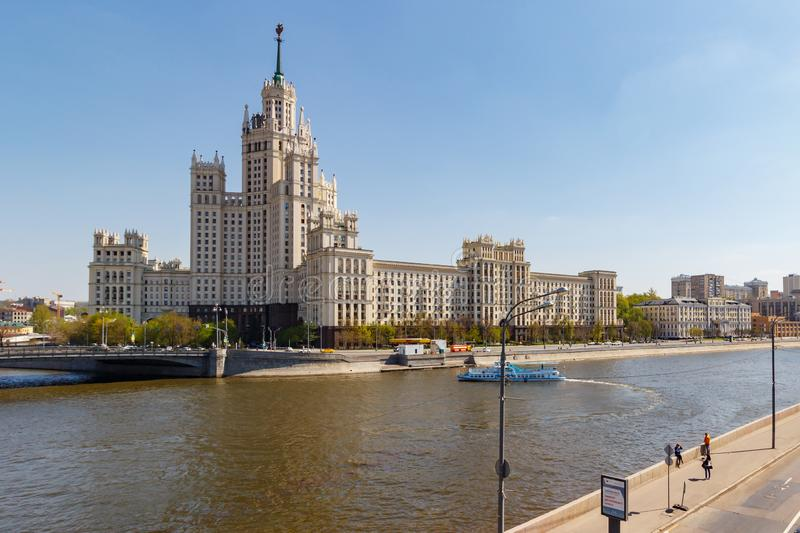 Moscow, Russia - May 01, 2019: Stalin skyscraper on Kotelnicheskaya Embankment in Moscow on a background of Moskva river stock photography