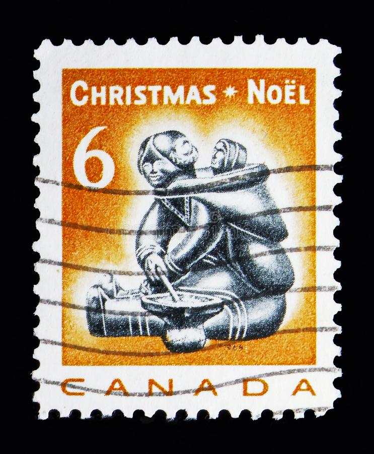 Mother and Child (carving), Christmas serie, circa 1968. MOSCOW, RUSSIA - MAY 13, 2018: A stamp printed in Canada shows Mother and Child (carving), Christmas royalty free stock photo