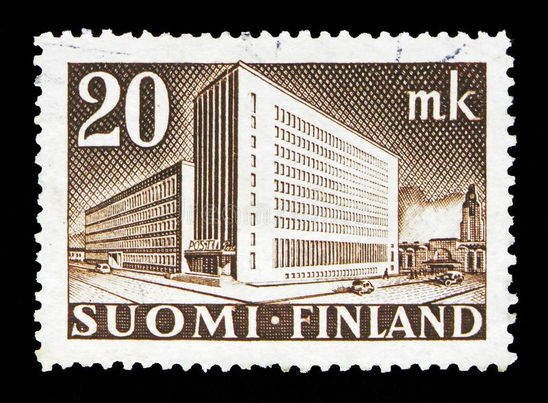 Post Administration Building, Helsinki, serie, circa 1945. MOSCOW, RUSSIA - MAY 13, 2018: A stamp printed in Finland shows Post Administration Building, Helsinki royalty free stock image