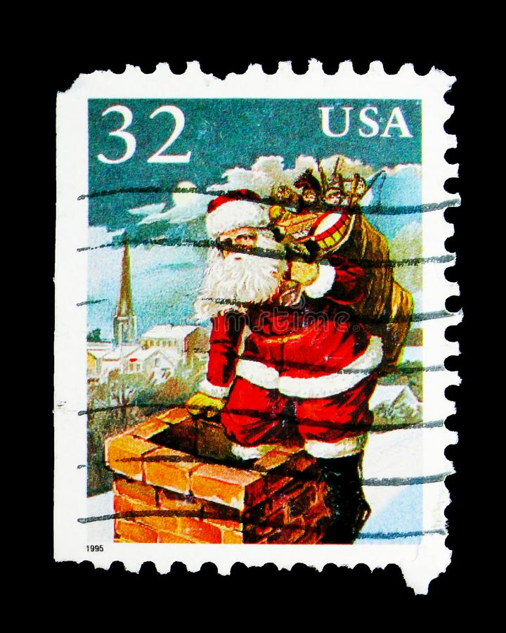 Christmas - Santa At Chimney, serie, circa 1995. MOSCOW, RUSSIA - MAY 15, 2018: A stamp printed in USA shows Christmas - Santa At Chimney, serie, circa 1995 royalty free stock photo
