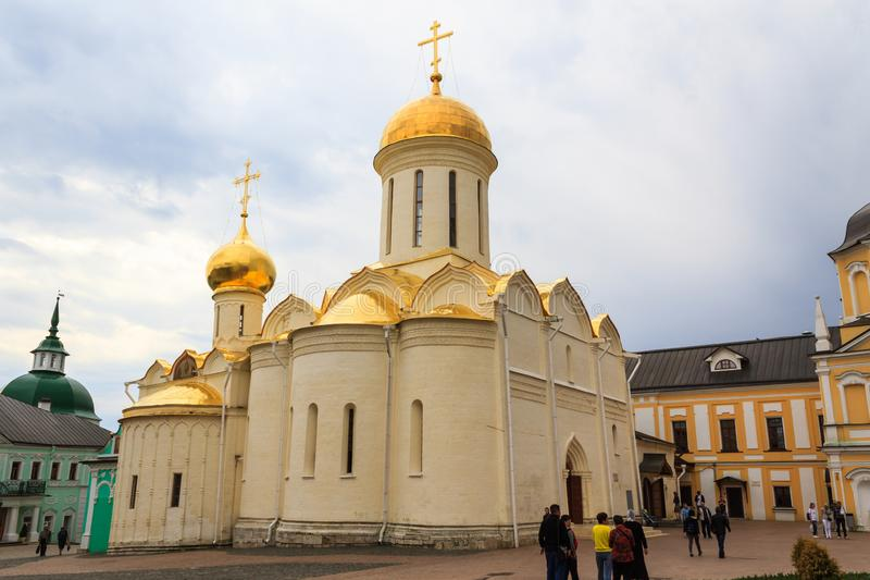 Tourists visit The Holy Trinity-St. Sergius Lavra, Sergiev Posad, Moscow district, Russia. stock photos