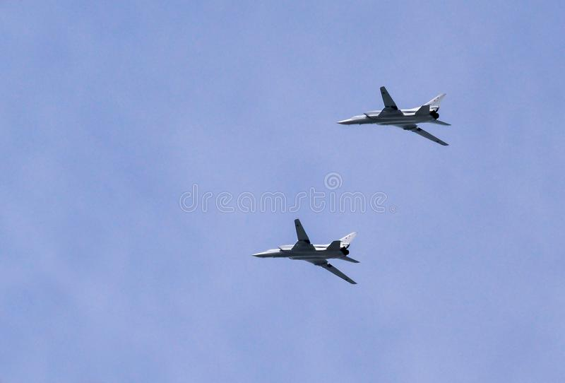 Moscow, Russia - May 9, 2018: Two Russian strategic Tupolev Tu-22M3 NATO reporting name: Backfire in flight at Parade of Victory. Moscow, Russia - May 9, 2018 royalty free stock photography