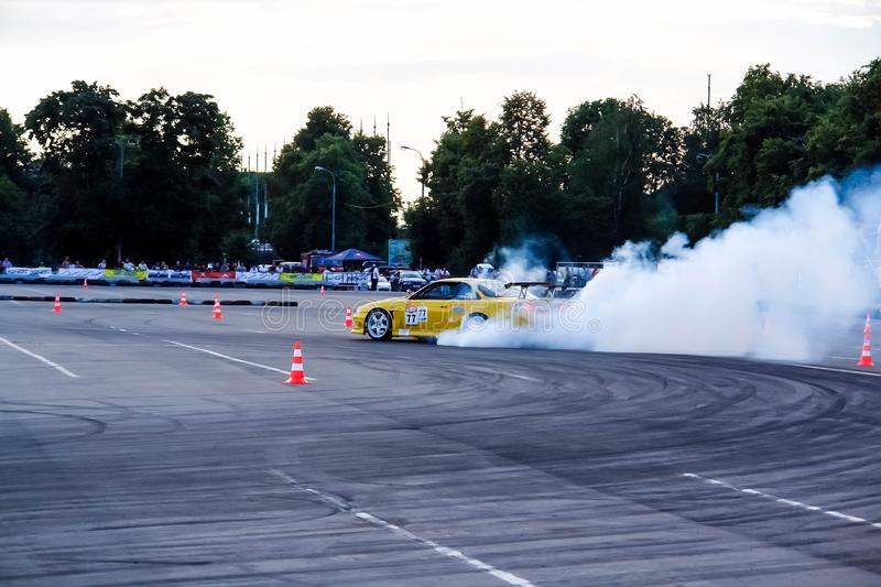 Moscow, Russia - May 25, 2019: Yellow Drift Nissan Silvia. Tuned car drift in the fenced area. Make burnout with a lot  of smoke. Moscow, Russia - May 25, 2019 royalty free stock photos