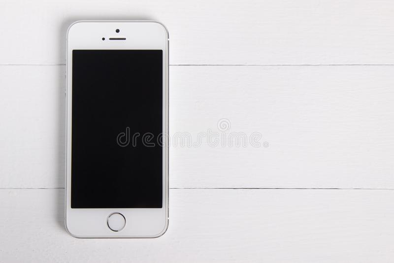 Moscow, Russia - November 1, 2018: Flat lay, front view of a silver white iPhone 5s. Product mock-up for ui, ux design royalty free stock image