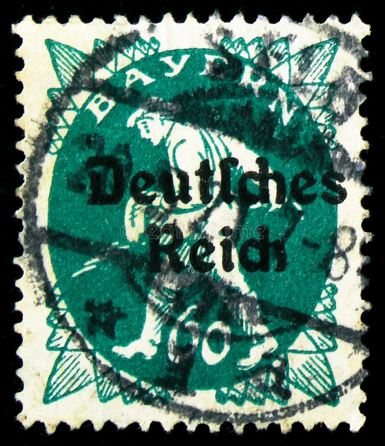 Postage stamp printed in German Realm shows Stamps of Bavaria overprinted Deutsches Reich, serie, circa 1920 royalty free stock images