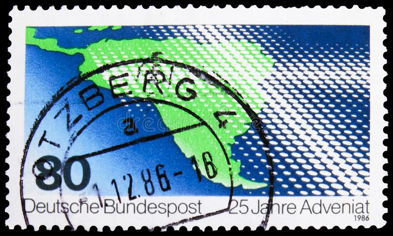 Postage stamp printed in Germany shows Cross over Map, ADVENIAT - Catholic relief for the Church in Latin America serie, circa. MOSCOW, RUSSIA - NOVEMBER 4, 2019 royalty free stock photos