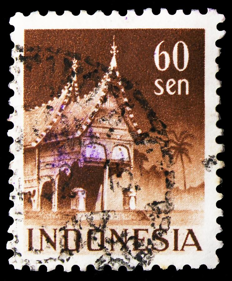 Postage stamp printed in Indonesia shows House with curved verges (menangkan style), West Sumatra, Building serie, circa 1949. MOSCOW, RUSSIA - NOVEMBER 4, 2019 stock photo