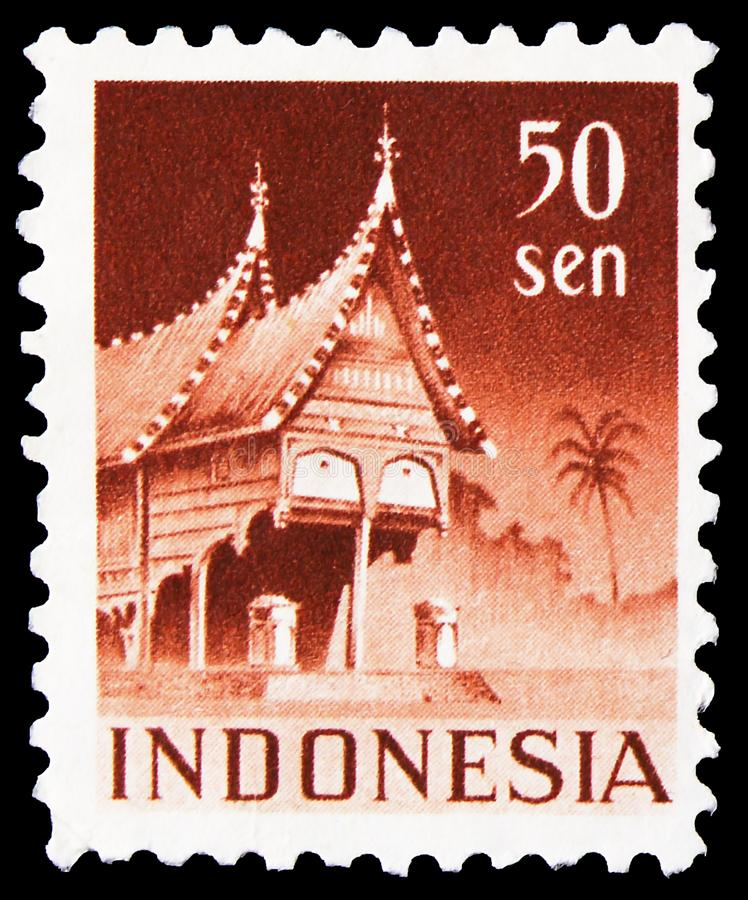 Postage stamp printed in Indonesia shows House with curved verges (Minangkabau style), West Sumatra, Building serie, circa 1949. MOSCOW, RUSSIA - NOVEMBER 4 stock photography