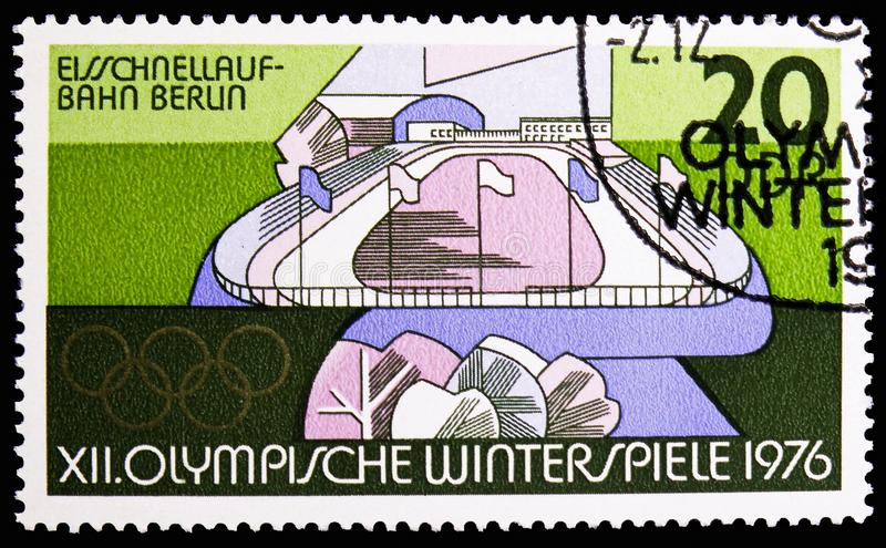 Speed Skating Rink, Berlin, Winter Olympics 1976, Innsbruck serie, circa 1975. MOSCOW, RUSSIA - NOVEMBER 10, 2018: A stamp printed in Germany, Democratic stock photos
