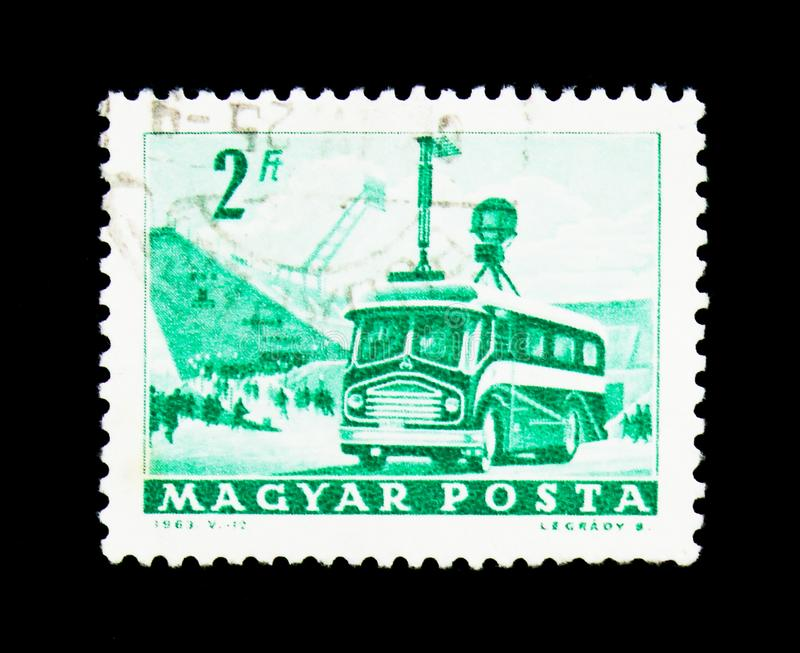 Mobile Radio Transmitter and Stadium, Transport and Telecommunic. MOSCOW, RUSSIA - NOVEMBER 25, 2017: A stamp printed in Hungary shows Mobile Radio Transmitter stock photography
