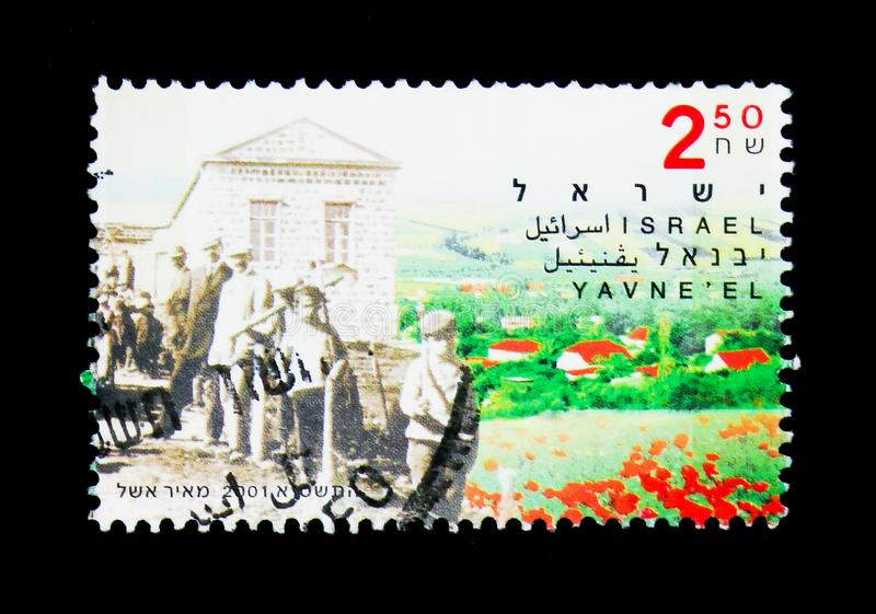 Yavne'el, Centenary of Yavne'el, Kfar Tavor & Menahamiya serie,. MOSCOW, RUSSIA - NOVEMBER 26, 2017: A stamp printed in Israel shows Yavne'el, Centenary of Yavne royalty free stock photos