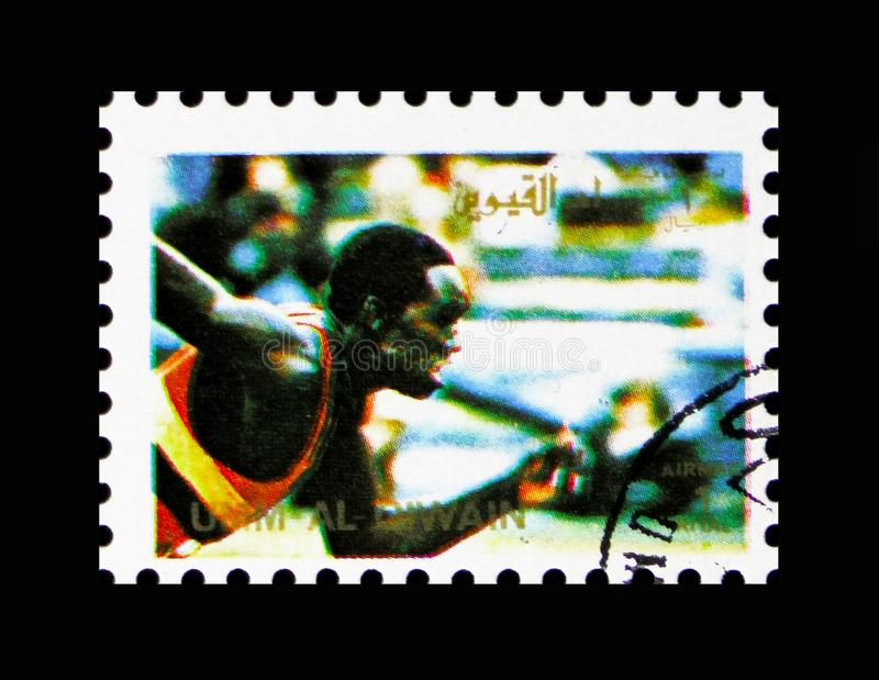 Running, Summer Olympics 1972, Munich; small format serie, circa 1972. MOSCOW, RUSSIA - NOVEMBER 10, 2018: A stamp printed in Umm al-Qaiwain shows Running stock photos