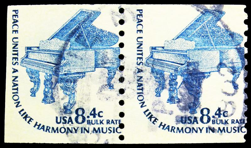 Two postage stamps printed in United States shows Steinway Grand Piano,1857, Americana Issue serie, circa 1978 stock photography