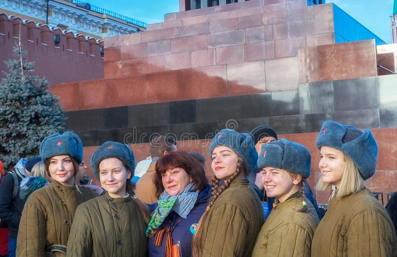 Young cadet girls in historical uniform with their tutor standing in a row near the Mausoleum royalty free stock photography