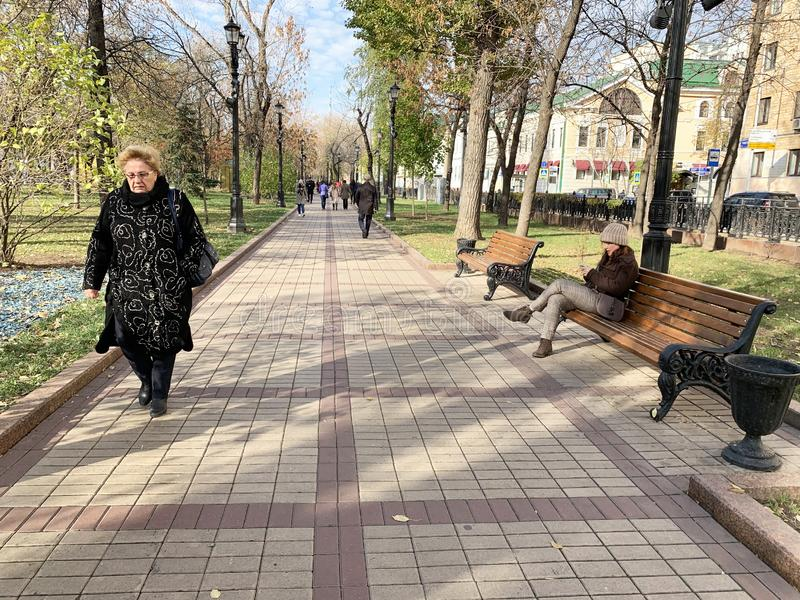 Moscow, Russia, October, 16, 2019. Elderly woman walking along Chistoprudny Boulevard in Moscow in the autumn. Moscow, Russia. Elderly woman walking along stock images