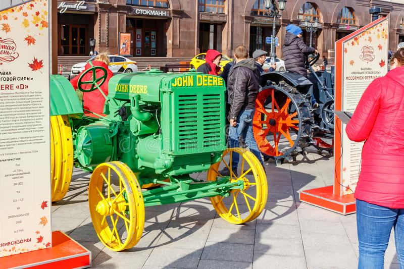 Moscow, Russia - October 08, 2019: Green american tractor with yellow wheels JOHN DEERE D Popping Johnnie on Revolution Square in. Moscow on the exhibition of royalty free stock photo