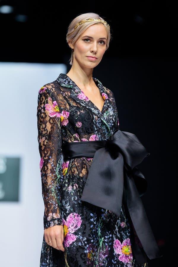 Model walk runway for KRAVETS and KARINA SARSENOVA catwalk at Spring-Summer 2017-2018 Season Moscow Fashion Week. MOSCOW, RUSSIA - OCTOBER 28, 2017: Model walk royalty free stock image