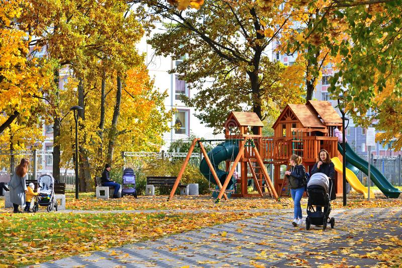 Moscow, Russia - October 3. 2019. Moms with children in the playground in the autumn park stock images