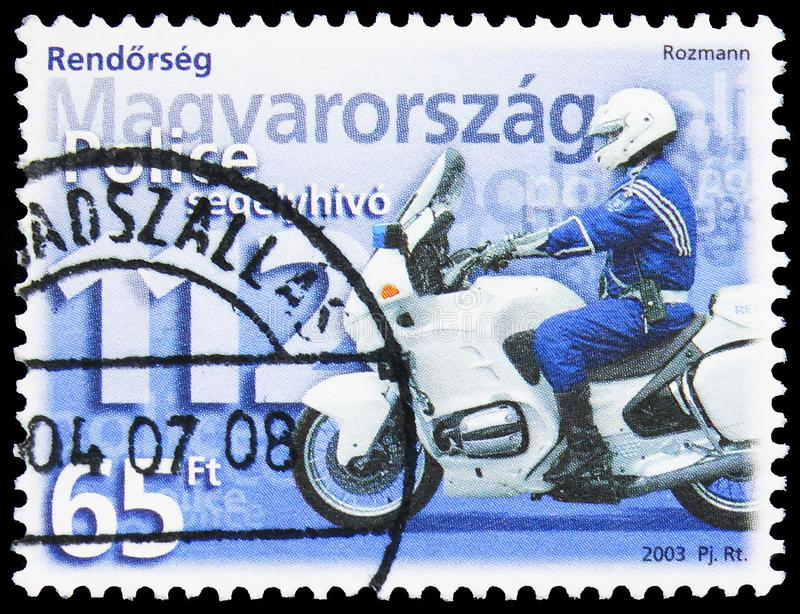Postage stamp printed in Hungary shows Policeman on motorbike and emergency phone number, Police serie, circa 2003 stock images
