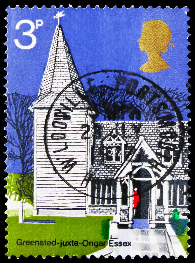 Postage stamp printed in United Kingdom shows St. Andrew's, Greensted-Juxta-Ongar, Essex, British Architecture, Village Churches. MOSCOW, RUSSIA - OCTOBER 4 royalty free stock images