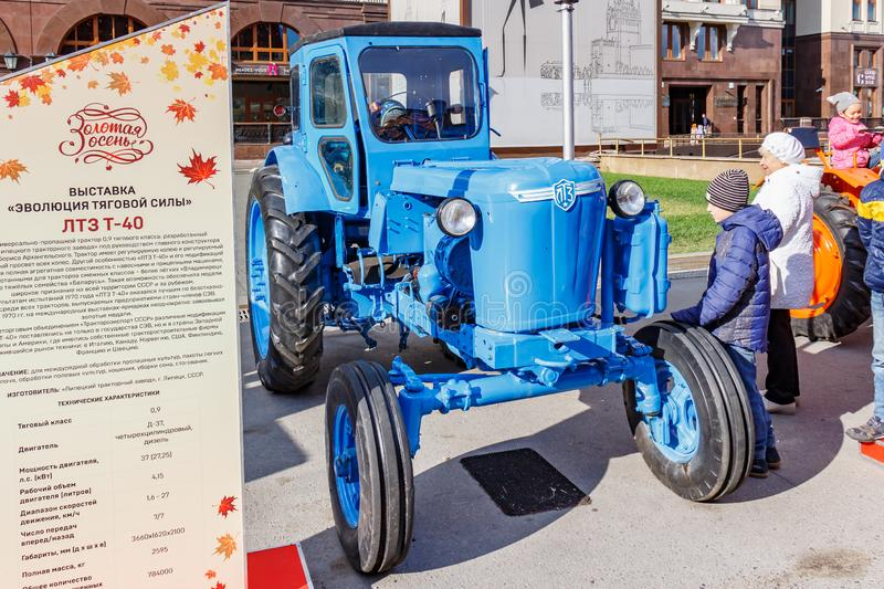 Moscow, Russia - October 08, 2019: Restored soviet wheel tractor LTZ T-40 on the traditional festival Golden Autumn on Revolution. Square in Moscow at sunny stock photography