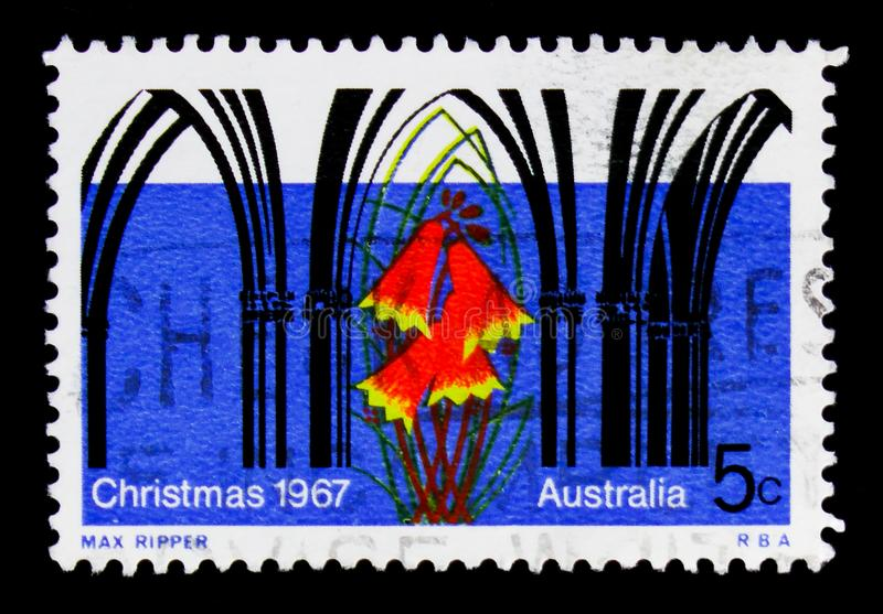Church facade in Gothic style, Blandfordia grandiflora, Christmas 1967 serie, circa 1967. MOSCOW, RUSSIA - OCTOBER 3, 2017: A stamp printed in Australia shows stock photo
