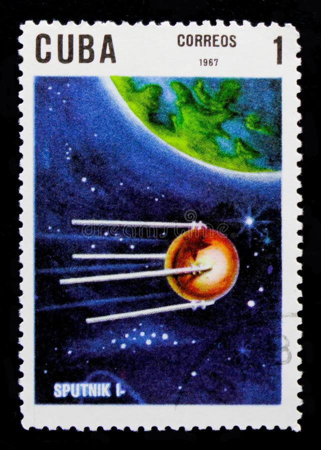 Sputnik 1, 10th Ann. Of The Launch Of The First Artificial Satellite serie, circa 1967. MOSCOW, RUSSIA - OCTOBER 1, 2017: A stamp printed in Cuba shows Sputnik 1 stock photography