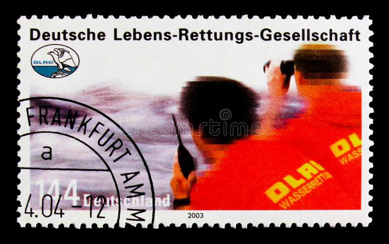MOSCOW, RUSSIA - OCTOBER 21, 2017: A stamp printed in German Fed. Eral Republic shows Life saving association, 90th Anniversary of DRLG (safety organisation) stock image