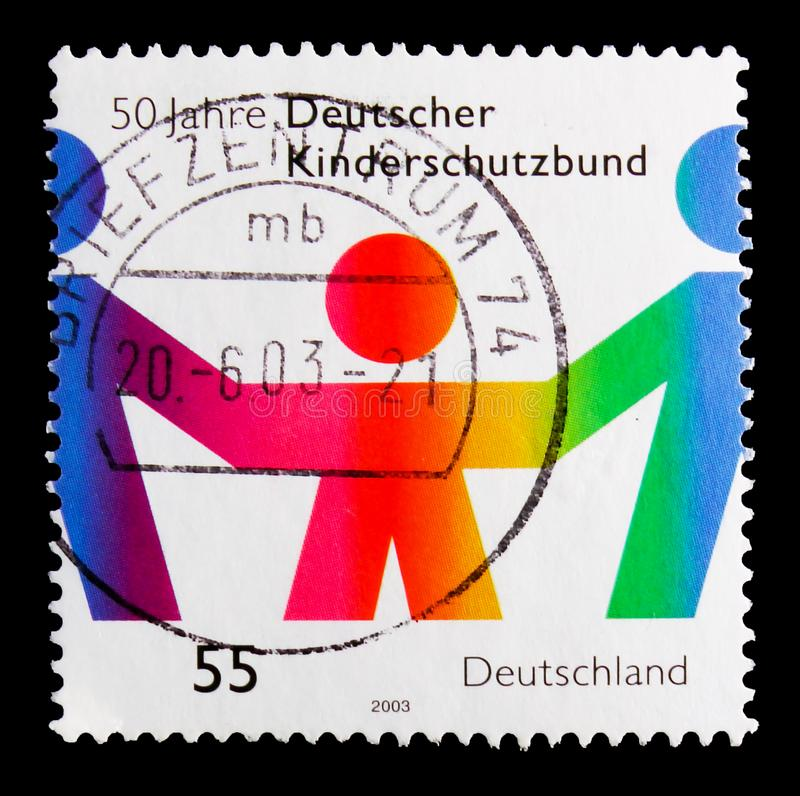 MOSCOW, RUSSIA - OCTOBER 21, 2017: A stamp printed in German Fed. Eral Republic shows Children protection, 50th anniversary serie, circa 2003 stock photo
