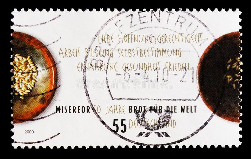 MOSCOW, RUSSIA - OCTOBER 21, 2017: A stamp printed in German Fed. Eral republic shows Bread for the World, 50 Years Misereor serie, circa 2009 royalty free stock photos