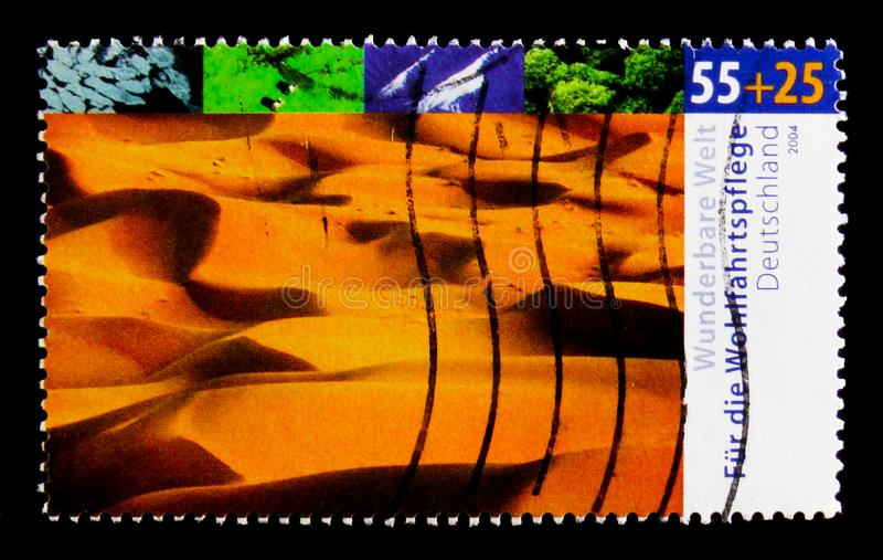 MOSCOW, RUSSIA - OCTOBER 21, 2017: A stamp printed in German Fed. Eral Republic shows Desert, Welfare: Wonderful world - climates serie, circa 2004 stock image