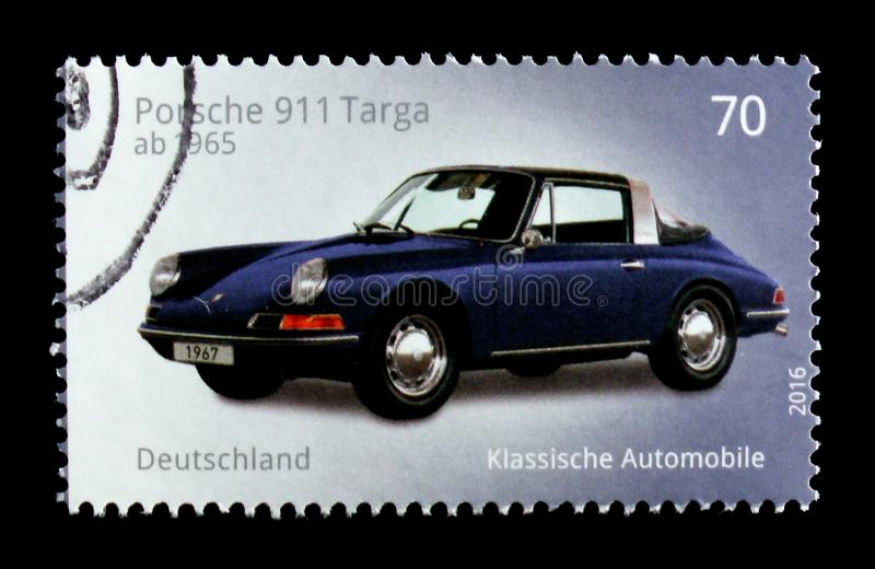 MOSCOW, RUSSIA - OCTOBER 21, 2017: A stamp printed in German Fed. Eral Republic shows Porsche 911 Targa, Old cars serie, circa 2016 royalty free stock photo