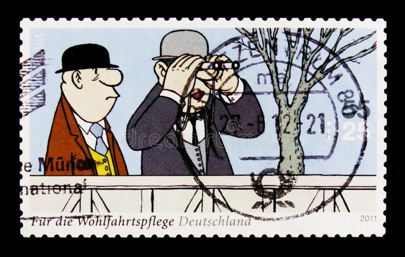 MOSCOW, RUSSIA - OCTOBER 21, 2017: A stamp printed in German Fed. Eral Republic shows Two racegoers (At the Racecourse), Welfare: Themes by Loriot serie, circa stock photos