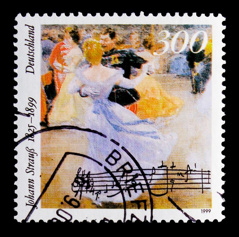 MOSCOW, RUSSIA - OCTOBER 21, 2017: A stamp printed in Germany Fe. Deral Republic shows Dancing people, Death Centenary of Johann Strauss the younger serie, circa royalty free stock photos