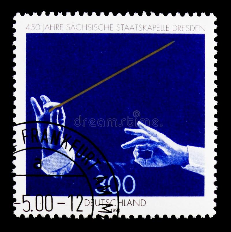MOSCOW, RUSSIA - OCTOBER 3, 2017: A stamp printed in Germany Fed. Eral Republic shows Saxony State Orchestra, 450th Anniversary of Saxon State Orchestra, Dresden stock photo
