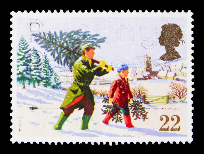 Fetching the Christmas Tree, Christmas 1990 serie, circa 1990. MOSCOW, RUSSIA - OCTOBER 3, 2017: A stamp printed in Great Britain shows Fetching the Christmas stock photo