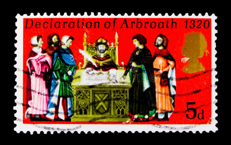 Signing the Declaration of Arbroath, Anniversaries 1970 serie, circa 1970. MOSCOW, RUSSIA - OCTOBER 3, 2017: A stamp printed in Great Britain shows Signing the stock photography