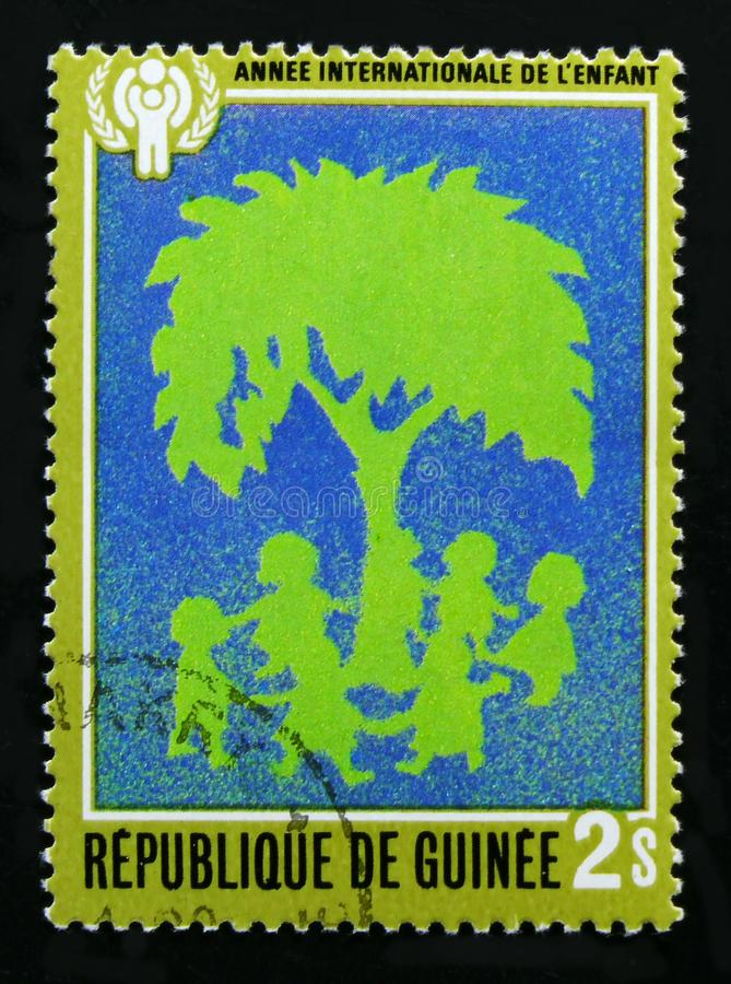 Guinea devoted to Year of the child, serie, circa 1980. MOSCOW, RUSSIA - OCTOBER 1, 2017: A stamp printed in Guinea devoted to Year of the child, serie, circa royalty free stock photo
