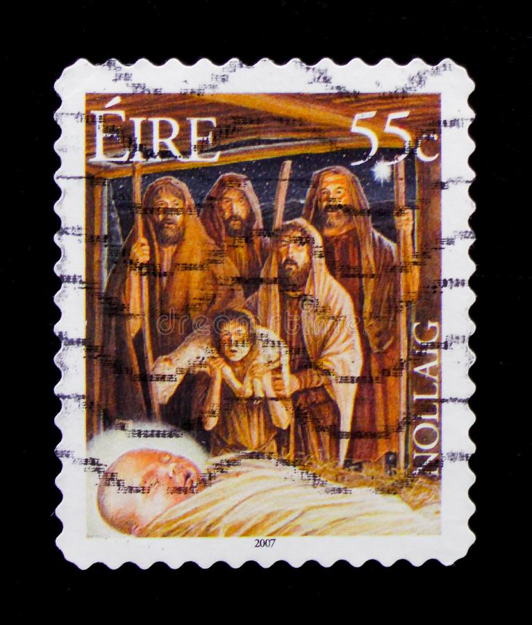 MOSCOW, RUSSIA - OCTOBER 1, 2017: A stamp printed in Ireland shows The Adoration of the Shepherds, Christmas 2007 serie, circa royalty free stock photography